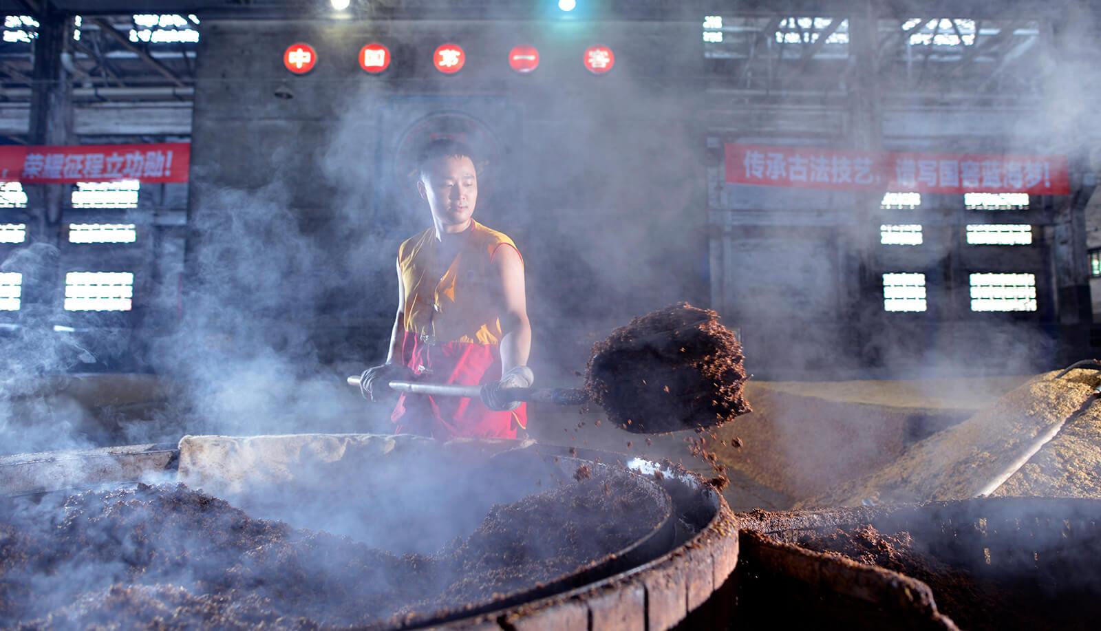 Removing mash at Ming River Luzhou Laojiao Baijiu Distillery